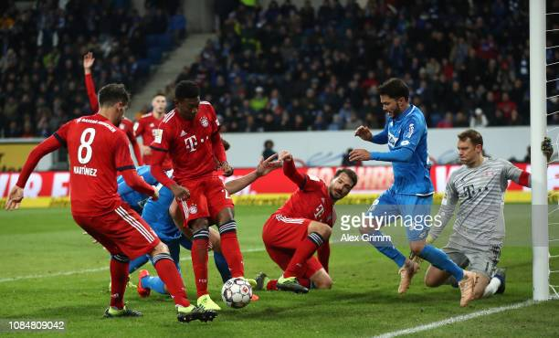 David Alaba of Bayern Munich clears during a goal mouth scramble during the Bundesliga match between TSG 1899 Hoffenheim and FC Bayern Muenchen at...