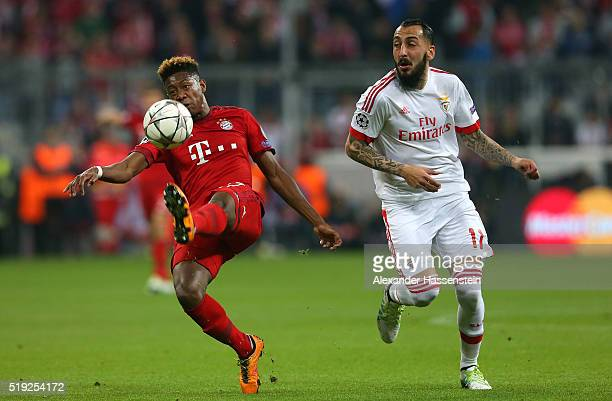 David Alaba of Bayern Munich clears the ball from Kostas Mitroglou of Benfica during the UEFA Champions League quarter final first leg match between...