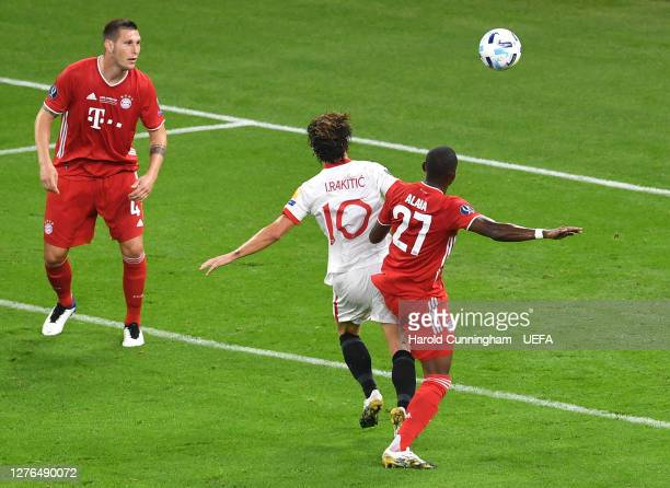 David Alaba of Bayern Munich fouls Ivan Rakitic of Sevilla FC and a penalty is later awarded to Sevilla FC during the UEFA Super Cup match between FC...