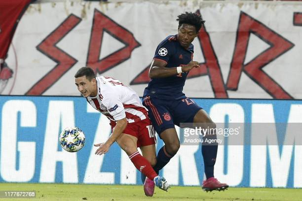 David Alaba of Bayern Munich in action against Daniel Podence of Olympiacos during the UEFA Champions League Group B match between Olympiacos and...