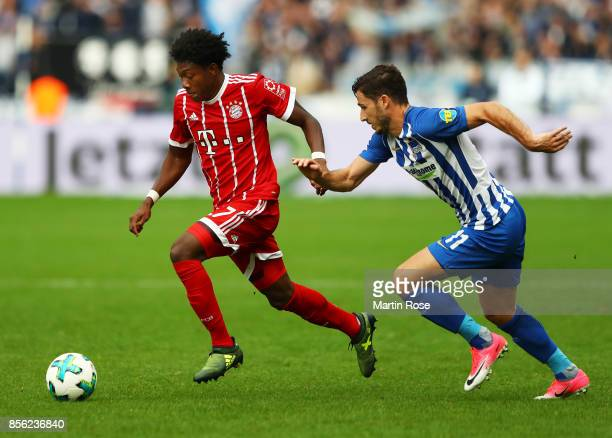 David Alaba of Bayern Munich is challenged by Matthew Leckie of Hertha Berlin during the Bundesliga match between Hertha BSC and FC Bayern Muenchen...