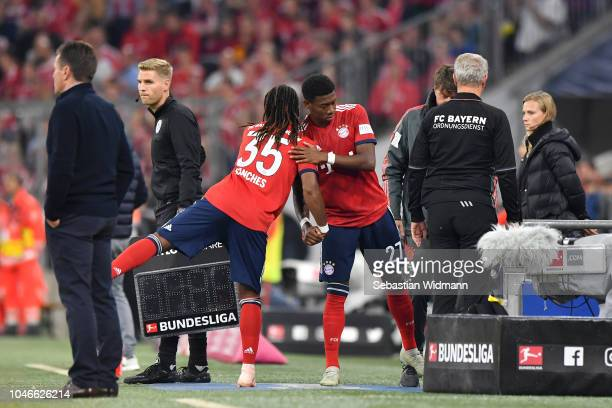 David Alaba of Bayern Munich is substituted for Renato Sanches of Bayern Munich during the Bundesliga match between FC Bayern Muenchen and Borussia...