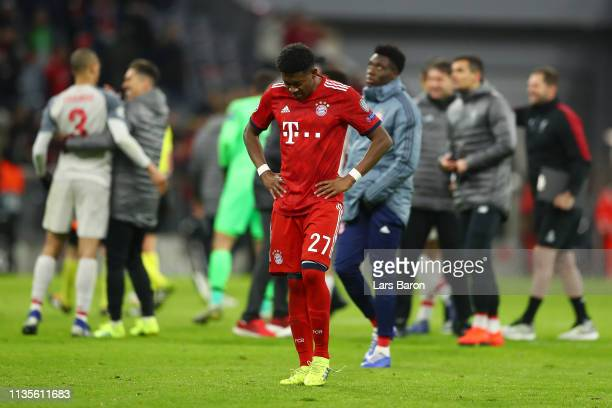 David Alaba of Bayern Munich looks dejected in defeat after the UEFA Champions League Round of 16 Second Leg match between FC Bayern Muenchen and...