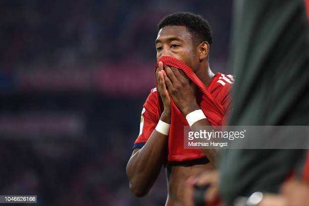 David Alaba of Bayern Munich reacts after picking up an injury during the Bundesliga match between FC Bayern Muenchen and Borussia Moenchengladbach...