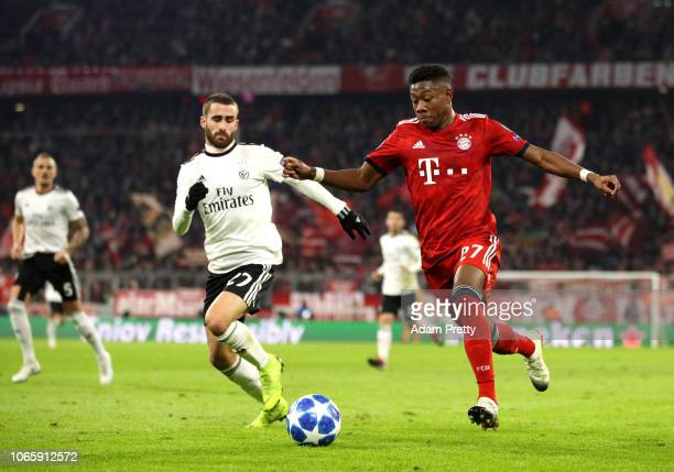 David Alaba of Bayern Munich takes on Rafa of Benfica during the UEFA Champions League Group E match between FC Bayern Muenchen and SL Benfica at...