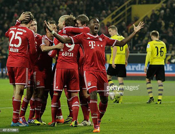 David Alaba of DFGC Bayern celebrates after Mario Gotze of FCBayern scores a goal during the Bundesliga match between FC Bayern and Bor Dortmund...