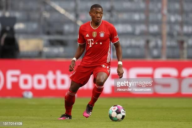 David Alaba of FC Bayern München runs with the ball during the Bundesliga match between FC Bayern Muenchen and Borussia Moenchengladbach at Allianz...