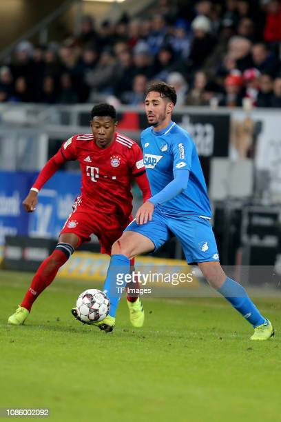 David Alaba of FC Bayern Muenchen and Ishak Belfodil of TSG 1899 Hoffenheim battle for the ball during the Bundesliga match between TSG 1899...