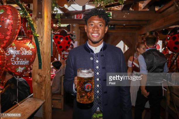 David Alaba of FC Bayern Muenchen attends the Oktoberfest at Kaefer Wiesenschaenke tent at Theresienwiese on October 06, 2019 in Munich, Germany.