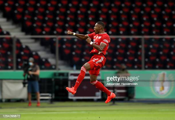 David Alaba of FC Bayern Muenchen celebrates after scoring his team's first goal during the DFB Cup final match between Bayer 04 Leverkusen and FC...