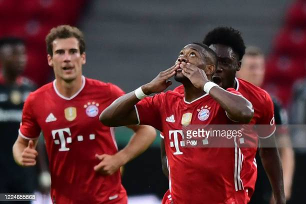 David Alaba of FC Bayern Muenchen celebrates after scoring the first goal for FC Bayern Muenchen with his teammates during the DFB Cup final match...