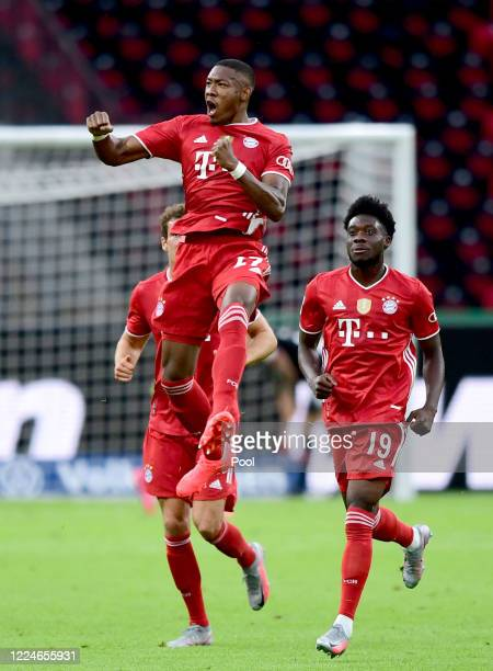 David Alaba of FC Bayern Muenchen celebrates after scoring the first goal for FC Bayern Muenchen with his team mates during the DFB Cup final match...