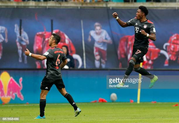 David Alaba of FC Bayern Muenchen celebrates his team's fourth goal during the Bundesliga match between RB Leipzig and Bayern Muenchen at Red Bull...