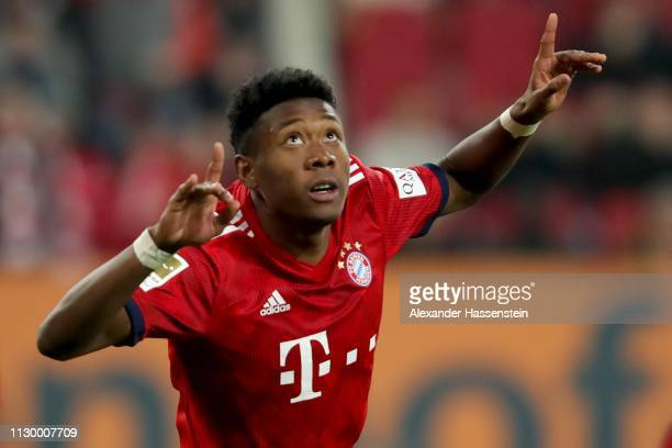 David Alaba of FC Bayern Muenchen celebrates scoring the 3rd goal during the Bundesliga match between FC Augsburg and FC Bayern Muenchen at WWKArena...