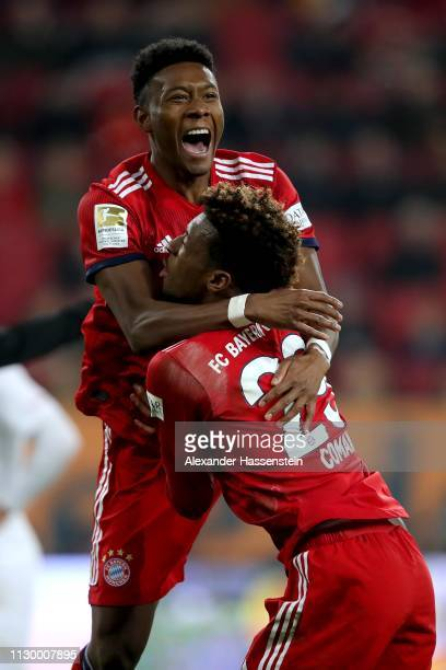 David Alaba of FC Bayern Muenchen celebrates scoring the 3rd goal with his team mate Kingsley Coman during the Bundesliga match between FC Augsburg...
