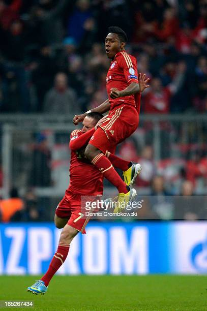 David Alaba of FC Bayern Muenchen celebrates with teammate Franck Ribery after scoring the opening goal during the UEFA Champions League quarter...