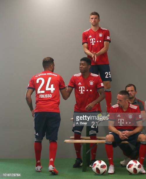 David Alaba of FC Bayern Muenchen congratulates his teammate Corentin Tolisso for the World Cup title during the team presentation at on August 13...