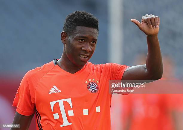 David Alaba of FC Bayern Muenchen gives a thumb up towards fans during a training session ahead of the team's friendly match against AC Milan on...