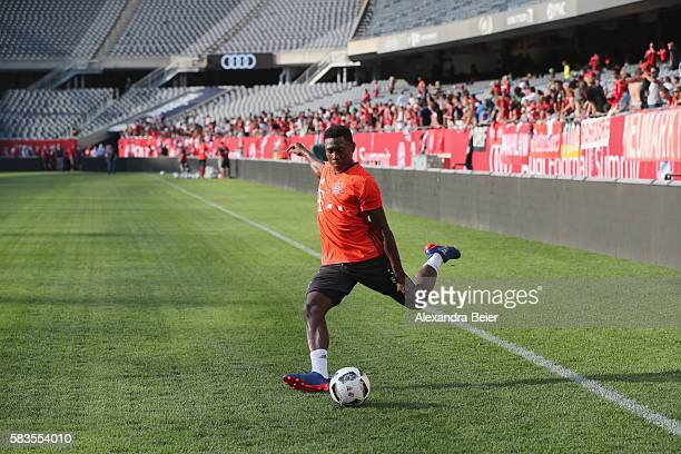 David Alaba of FC Bayern Muenchen kicks the ball during a training session ahead of the team's friendly match against AC Milan on Wednesday at the...