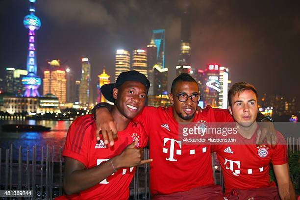 David Alaba of FC Bayern Muenchen looks on with his team mates Jerome Boateng and Mario Goetze at the Audi quattro Cup 2015 Night Gala at Bar Rouge...