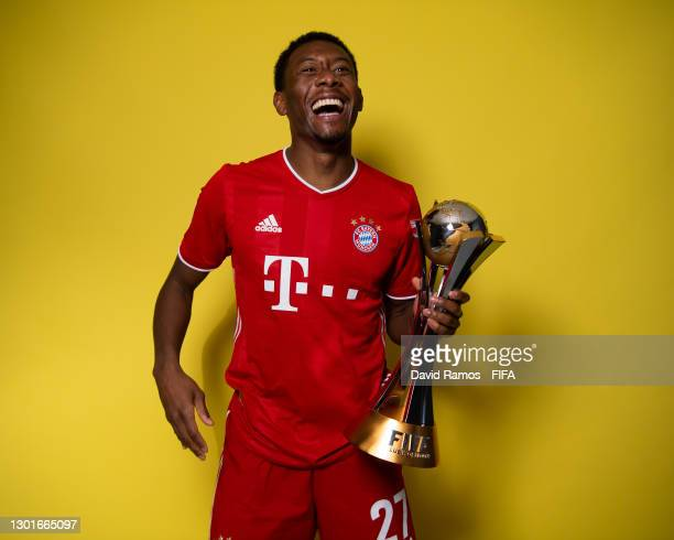 David Alaba of FC Bayern Muenchen poses with the trophy after winning the FIFA Club World Cup Qatar 2020 Final between FC Bayern Muenchen and Tigres...