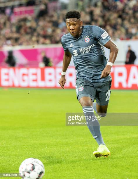 David Alaba of FC Bayern Muenchen runs with the ball during the Telekom Cup 2019 semifinal match between Fortuna Duesseldorf and FC Bayern Muechen at...