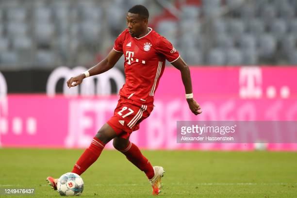 David Alaba of FC Bayern Muenchen runs with the ball during the Bundesliga match between FC Bayern Muenchen and Borussia Moenchengladbach at Allianz...