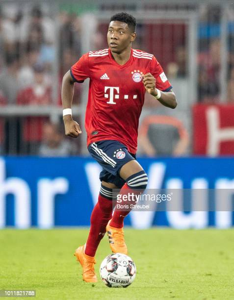 David Alaba of FC Bayern Muenchen runs with the ball during the friendly match between Bayern Muenchen and Manchester United at Allianz Arena on...