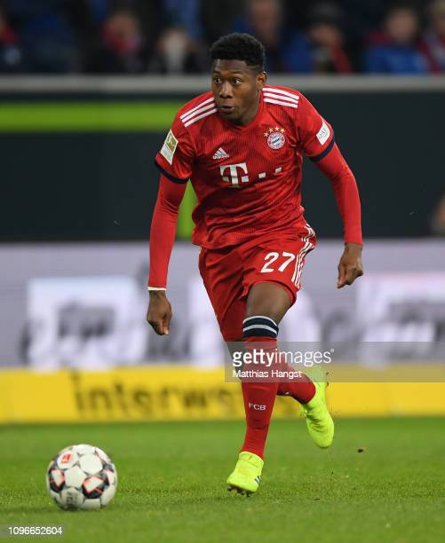 David Alaba of FC Bayern Muenchen runs with the ball during the Bundesliga match between TSG 1899 Hoffenheim and FC Bayern Muenchen at PreZeroArena...