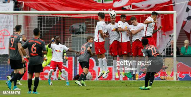 David Alaba of FC Bayern Muenchen scores his team's fourth goal with a freekick during the Bundesliga match between RB Leipzig and Bayern Muenchen at...