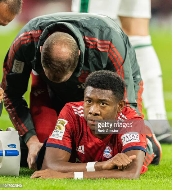 David Alaba of FC Bayern Muenchen takes an injury during the Bundesliga match between FC Bayern Muenchen and Borussia Moenchengladbach at Allianz...