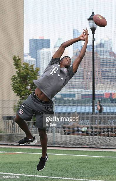 David Alaba of FC Bayern Muenchen tries to catch an American football during an activity event in front of New York's skyline on August 2 2016 in...