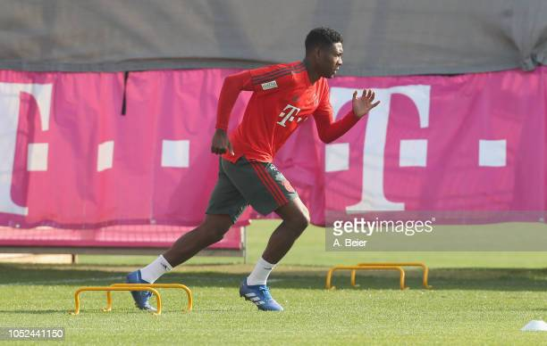 David Alaba of FC Bayern Muenchen warm up during a training session at the club's Saebener Strasse training ground on October 18 2018 in Munich...