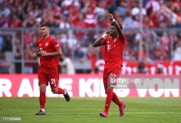 David Alaba of FC Bayern Munich celebrates after scoring his team's second goal during the Bundesliga match between FC Bayern Muenchen and 1 FSV...