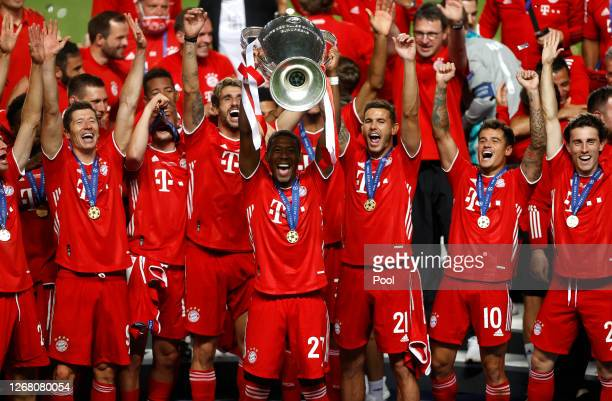 David Alaba of FC Bayern Munich lifts the Champions League Trophy following his team's victory in during the UEFA Champions League Final match...