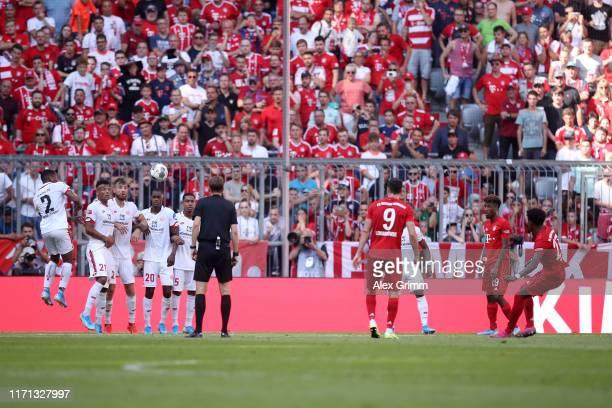 David Alaba of FC Bayern Munich scores his team's second goal during the Bundesliga match between FC Bayern Muenchen and 1 FSV Mainz 05 at Allianz...