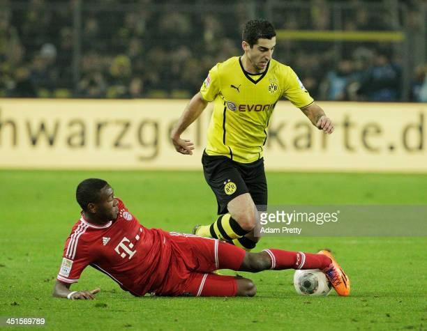 David Alaba of FCBayern tackles Henrikh Mkhitaryan of Bor Dortmund during the Bundesliga match between FC Bayern and Bor Dortmund Signal Iduna Park...