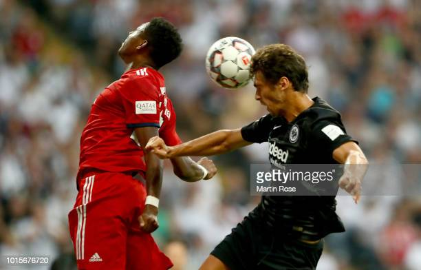 David Alaba of Frankfurt and Lucas Torro of Muenchen head for the ball during the DFL Supercup 2018 between Eintracht Frankfurt and Bayern Muenchen...