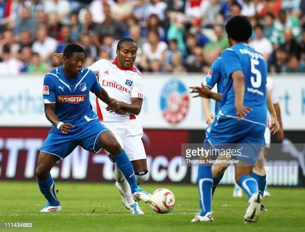 David Alaba of Hoffenheim battles for the ball with Ze Roberto of Hamburg during the Bundesliga match between TSG 1899 Hoffenheim and Hamburger SV at...