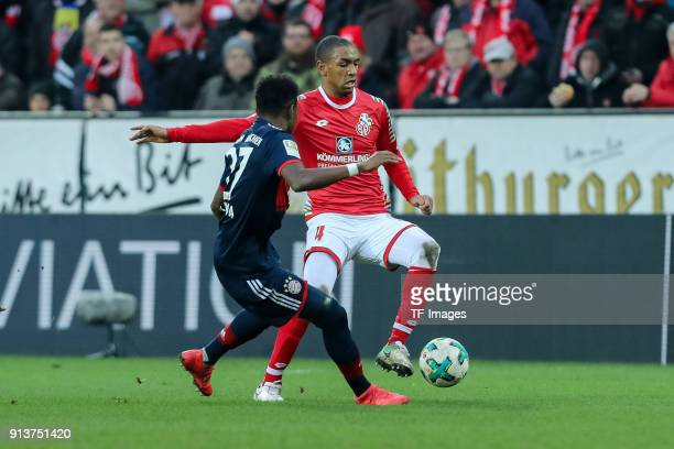 David Alaba of Muenchen and Abdou Diallo of Mainz battle for the ball during the Bundesliga match between 1 FSV Mainz 05 and FC Bayern Muenchen at...