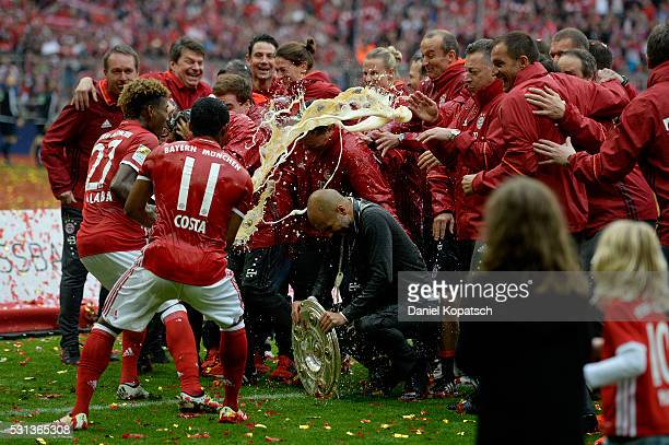 David Alaba of Muenchen and Douglas Costa of Muenchen celebrate with staffs after the Bundesliga match between FC Bayern Muenchen and Hannover 96 at...