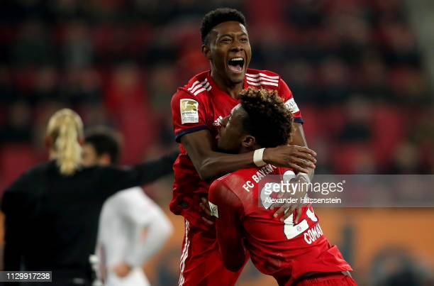 David Alaba of Muenchen celebrate with team mate Kingsley Coman after he scores the 3rd goal during the Bundesliga match between FC Augsburg and FC...