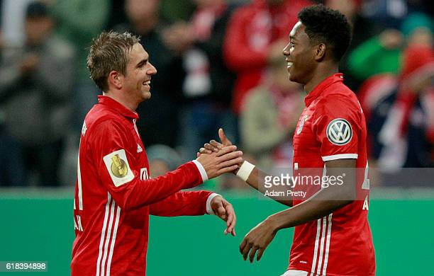 David Alaba of Muenchen celebrate with team mate Philipp Lahm after he scores the third goal during the DFB Cup second round match between Bayern...
