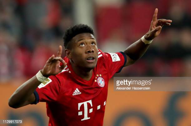 David Alaba of Muenchen celebrates after he scores the 3rd goal during the Bundesliga match between FC Augsburg and FC Bayern Muenchen at WWKArena on...