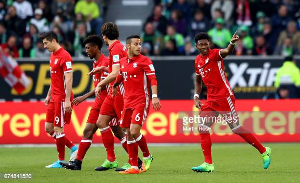 David Alaba of Muenchen celebrates after scoring the opening goal the Bundesliga match between VfL Wolfsburg and Bayern Muenchen at Volkswagen Arena...