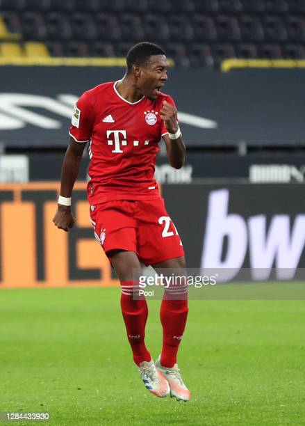 David Alaba of Muenchen celebrates his team's first goal during the Bundesliga match between Borussia Dortmund and FC Bayern Muenchen at Signal Iduna...