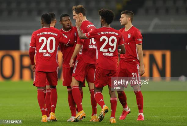 David Alaba of Muenchen celebrates his team's first goal with teammates during the Bundesliga match between Borussia Dortmund and FC Bayern Muenchen...