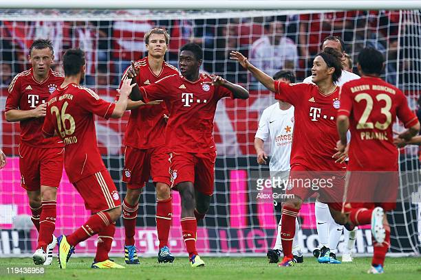 David Alaba of Muenchen celebrates his team's first goal with team mates during the LIGA total! Cup 3rd place match between FSV Mainz 05 and Bayern...