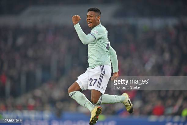 David Alaba of Muenchen celebrates his teams second goal during the Bundesliga match between Hannover 96 and FC Bayern Muenchen at HDI-Arena on...