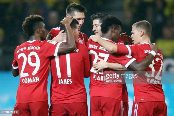 David Alaba of Muenchen celebrates his team's third goal with team mates during the Bundesliga match between Borussia Dortmund and FC Bayern Muenchen...